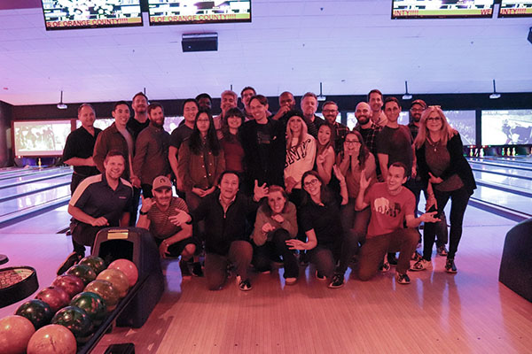 IntelliSurvey employees bowling together
