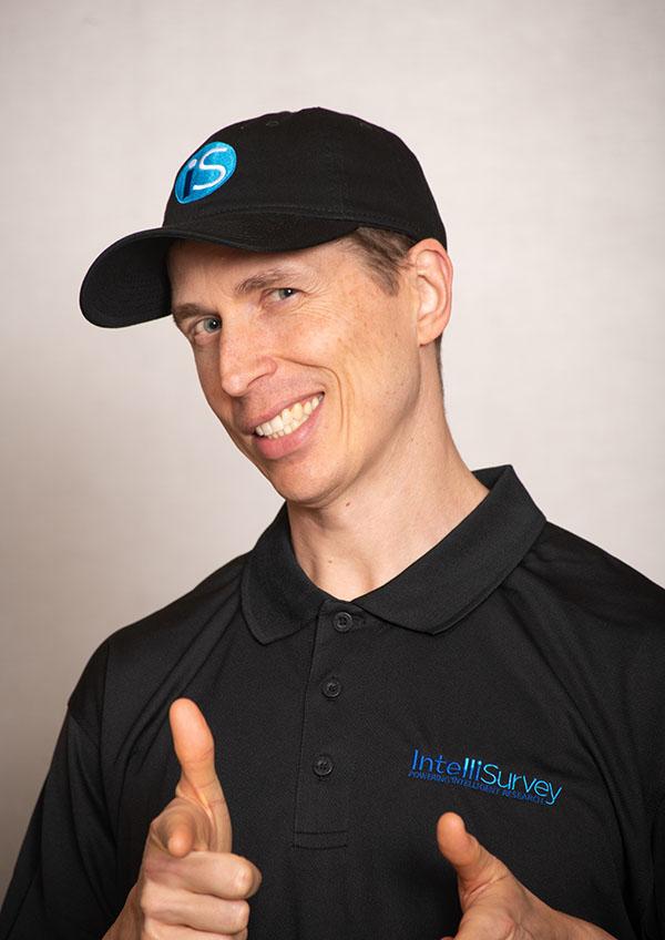 IntelliSurvey's employee giving a thumbs up