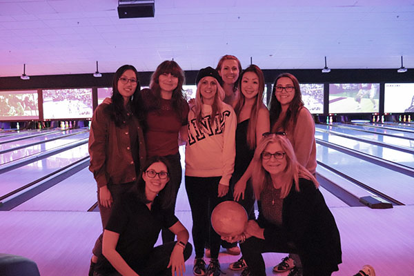 IntelliSurvey lady employees bowling