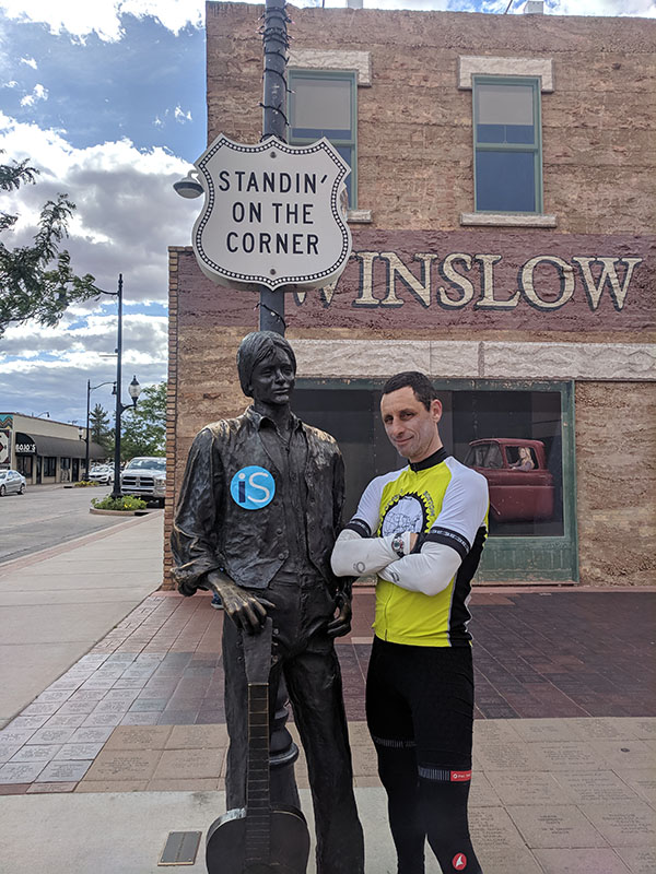 IntelliSurvey's employee posing next to a statue on the street