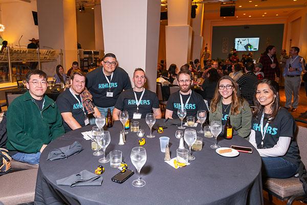 IntelliSurvey's employees team The Kihlers sitting together