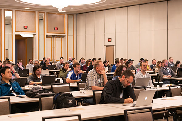IntelliSurvey employees at a convention